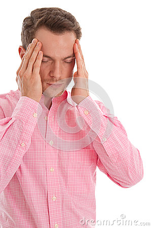 Stressed young man in pink with head in hands isolated on white