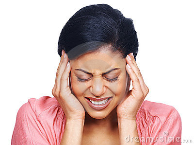 Stressed young woman suffering from headache