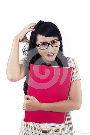 Stressful female student on white background