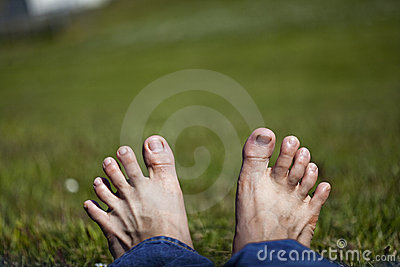 Stretched toes relaxing  on Grass