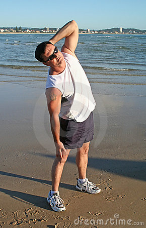 Stretching Exercises On The Beach