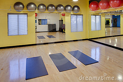 Stretching mats and exercise balls in gym