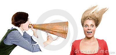Strict boss shouting at businesswoman through old