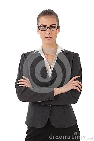 Strict businesswoman with arms folded