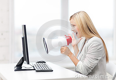 Strict businesswoman shouting in megaphone