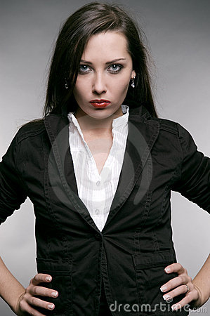 Strict woman in black jacket