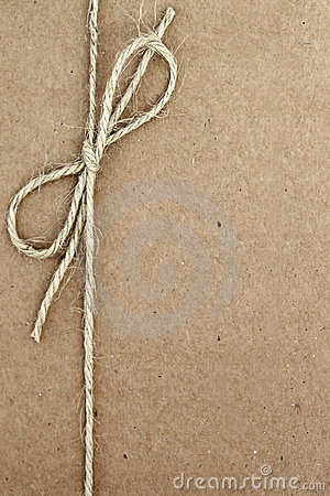 String Bow On Brown Paper Stock Photo Image 22999590