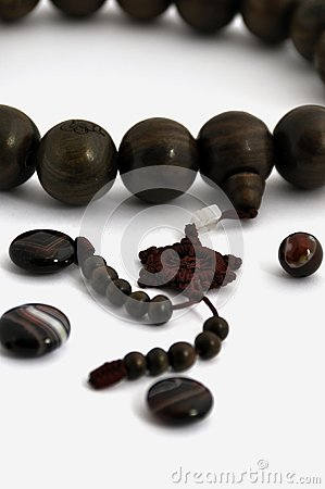 A string of wooden beads and agates ball