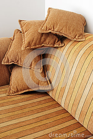 Striped brown sofa and four pillows