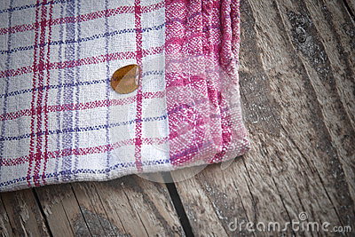 Striped dish cloth on brown wood