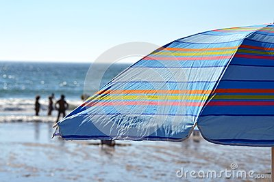 Striped parasol on the beach