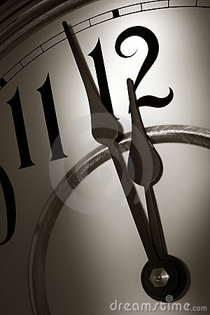 Free Stroke Of Midnight On A Clock In Dramatic Light Royalty Free Stock Photography - 7329837
