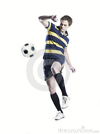 Strong athlete kicking the ball