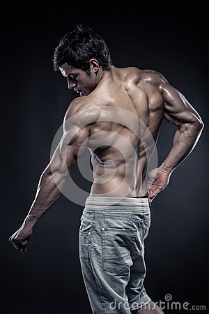 Free Strong Athletic Man Fitness Model Posing Back Muscles Royalty Free Stock Images - 39530859