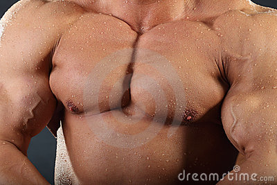 Strong chest and hand muscles of bodybuilder