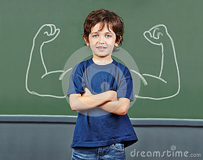 Strong child with muscles in school