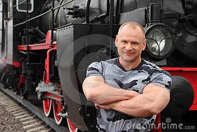 Strong man against locomotive