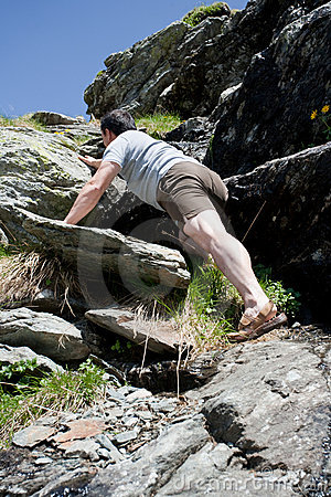 Strong man climbing mountain