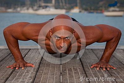 Strong man doing press ups
