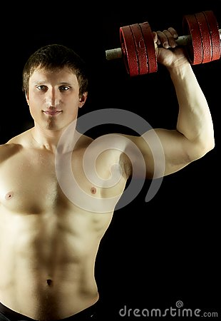 Strong man keeps dumbbell