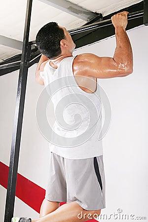 Strong man performing pull ups