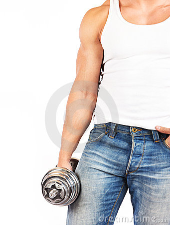 Strong muscullar man holding chromed dumbbell