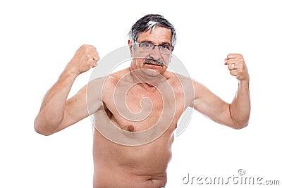 Strong senior man posing