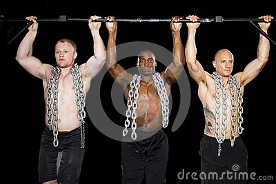 Strong sexy men perform pullups