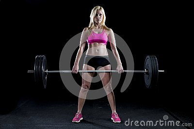 Strong sexy woman deadlifts a lot of weight