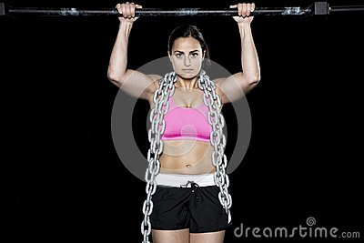 Strong sexy woman does a pull up