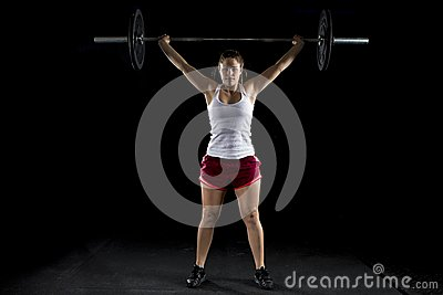 Strong sexy woman snatches a lot of weight