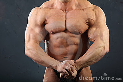 Strong torso and hand muscles of bodybuilder