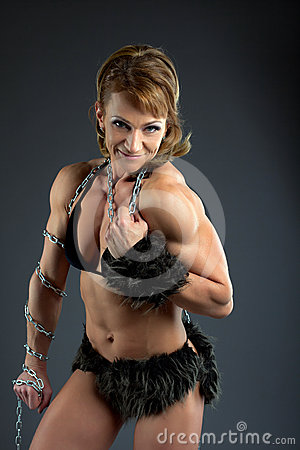 Strong woman body builder smile with chain