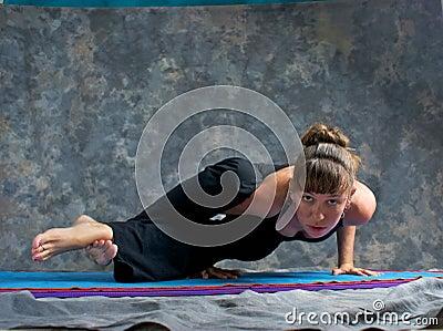 Strong woman doing yoga sage pose