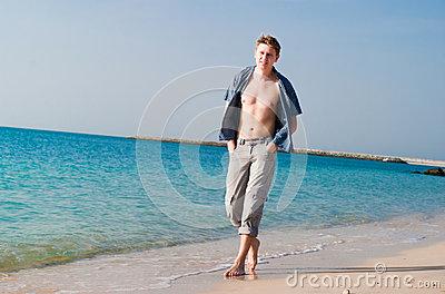Strong young man at beach