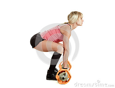 Strong young woman with barbell
