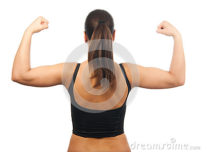 Strong young woman showing her muscles