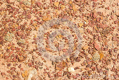 Structure of red clay with rocks