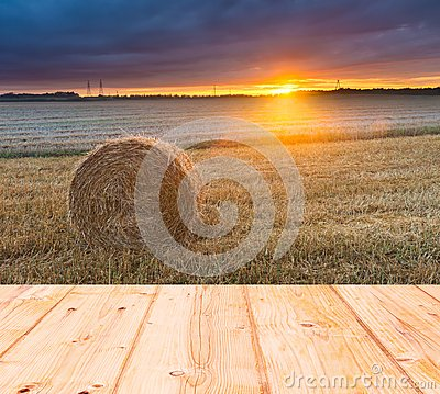 Free Stubble Field At Sunset With Old Wooden Planks Floor On Foreground Stock Photo - 52744050