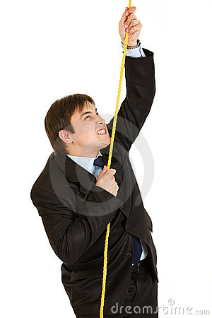 Stubborn businessman climbing up on rope