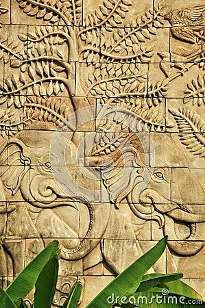 Stucco carved wall depicting elephants