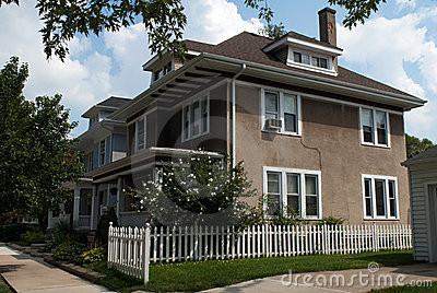 Stucco House with Picket Fence