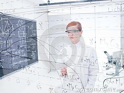 Student analyzing data and formulas