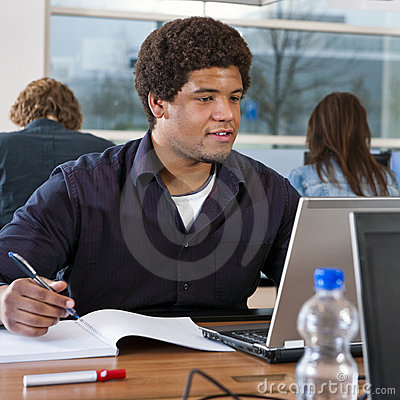 Student behind laptop