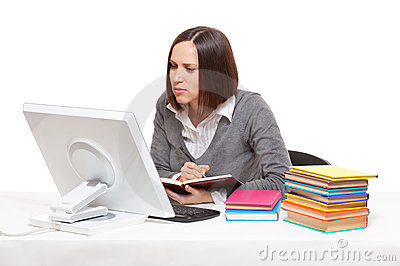 Student with books and computer