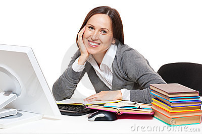 Student with books sitting on workplace