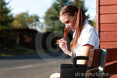 Student at bus stop