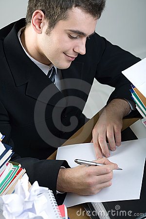 Student or businessman writing something on blank paper sh