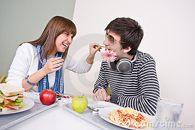 Student cafeteria - teenage couple having fun