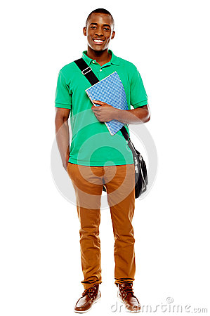 Student carrying laptop bag and notebook